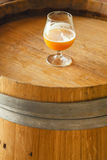 Wheat ale on a wooden barrel Royalty Free Stock Photo