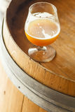 Wheat ale on a wooden barrel Royalty Free Stock Image