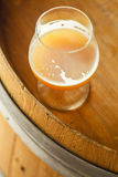 Wheat ale on a wooden barrel Royalty Free Stock Images
