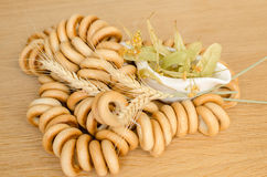 Wheat bagels and linden flowers Stock Photography