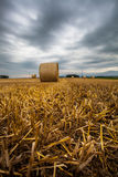 Wheat Bale and Storm Clouds Stock Photography