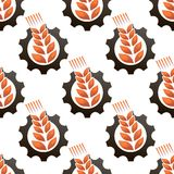 Wheat or barley inside a gear seamless pattern. Seamless background pattern of an ear of wheat or barley inside a gear wheel conceptual of industry in Stock Image