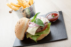 Wheat beef sandwich hamburger, fried potatoes, ketchup served fo Stock Image