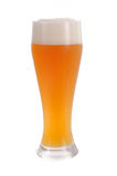 Wheat beer. Fresh poured light wheat beer Stock Photography