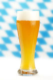 Wheat beer. With blue and white bavarian rhombus background Royalty Free Stock Photo