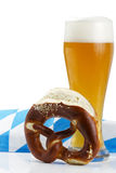 Wheat beer with bavarian towel and pretzel Stock Photos
