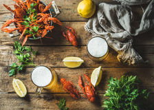 Wheat beer and boiled crayfish with lemon, parsley Royalty Free Stock Images