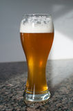 Wheat beer glass with foam Royalty Free Stock Photography