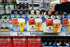 Wheat beer in a store. GERMANY - MAY 2017: Shelf with Benediktiner Weissbier carton 6 packs in a REWE supermarket Royalty Free Stock Images