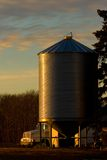 Wheat Bin. An agricultural storage bin lit with early morning light royalty free stock photography