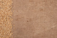 Wheat border on burlap background Royalty Free Stock Image