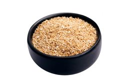 Wheat bran. Bowl of wheat bran on white background. It is common ingredient of healthy meal Stock Image