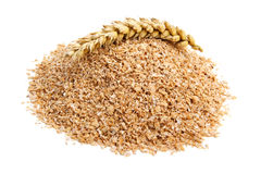 Wheat bran. With ear on white background. It is common ingredient of healthy meal Royalty Free Stock Photo
