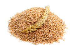 Wheat bran. With ear on white background. It is common ingredient of healthy meal Stock Photos