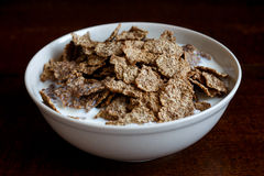 Wheat bran breakfast cereal in bowl. Stock Image
