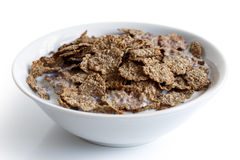 Wheat bran breakfast cereal in bowl. Royalty Free Stock Image