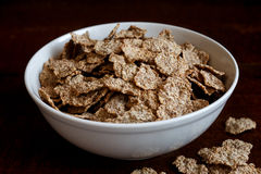 Wheat bran breakfast cereal in bowl. Stock Photos