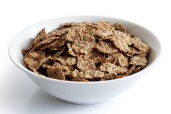 Wheat bran breakfast cereal in bowl. Royalty Free Stock Photos