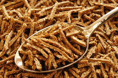 Wheat Bran Cereal on Spoon Stock Images