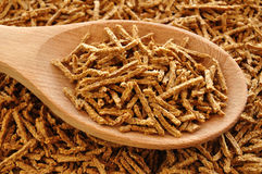 Wheat Bran Cereal on Wooden Spoon Royalty Free Stock Photo