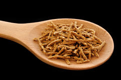 Wheat Bran Cereal on Wooden Spoon Stock Photography
