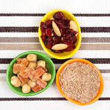 Wheat bran, nuts, dried fruits and berries Royalty Free Stock Photography