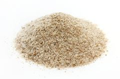 Wheat bran or oat bran pile on white background royalty free stock photo