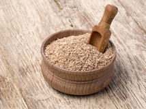 Wheat bran in a small wooden bowl Royalty Free Stock Photography