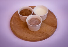 Wheat bran, yogurt and mix of them in white bowls on wooden plate Stock Image