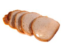 Wheat bread. Slices of bread on white background Royalty Free Stock Image