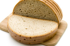 Wheat bread. Cut wheat bread and on edge board Royalty Free Stock Image