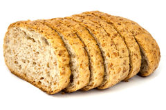 Wheat bread. With whole corns on white background stock photography