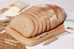 Wheat bread. Cut on slices stock photos