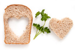 Wheat Bread. Slice with Heart and parsley royalty free stock images