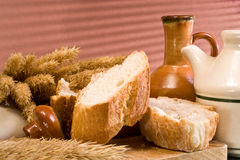 Wheat bread. Composition with flavorful slices of bread and cereal ears Royalty Free Stock Photo