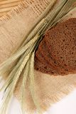 Wheat, bread on a bast mat Stock Images