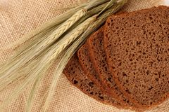 Wheat, bread on a bast mat Royalty Free Stock Images