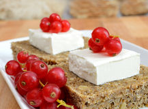 Wheat bread cheese and red fruit Royalty Free Stock Images