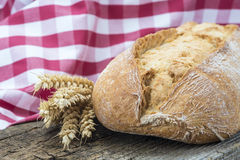 Wheat bread on a cuttig board Royalty Free Stock Photos