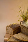 Wheat bread on cutting board Royalty Free Stock Photos