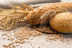 Wheat bread, ears and grain on sackcloth. Wheat bread, ears of wheat and grain on sackcloth Stock Photo
