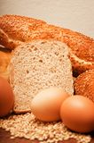 Wheat bread, grain and ears with eggs Stock Photo