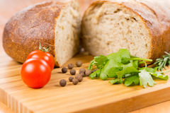 Wheat bread and herbs Royalty Free Stock Image