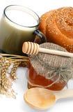 Wheat bread with honey jar Stock Photos