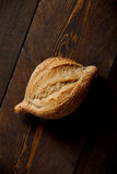 Wheat bread. Individual wheat bread on wooden table Royalty Free Stock Images