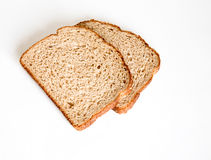 Wheat Bread 'mmm' Good. A shot of two slices of wheat bread lying on a white background Royalty Free Stock Images