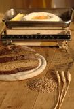 Wheat with bread and old kitchen scales Royalty Free Stock Photos