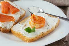 Wheat bread toasts with cream cheese, smoked salmon and shrimp Royalty Free Stock Photography
