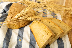 Wheat bread on a towel Stock Photos