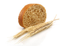 Wheat bread and Wheat. A wheat bread and shock of wheat on a white background Stock Photos
